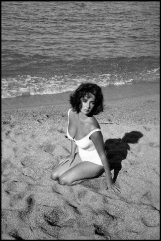 "Spain. Sagaro. 1959. Twenty-five-year-old Elizabeth Taylor on the set of ""Suddenly Last Summer"", in which she co-stars with Katharine Hepburn and Montgomery Clift. It is Taylor's first film after the death of her 3rd husband, Mike Todd, in a plane crash. , by Burt Glinn"