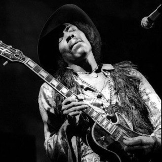 Elliott Landy, Jimi Hendrix, Fillmore East, NYC, 1968. Playing Gibson Les Paul.